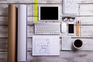 Desk, gadgets and office supplies. Flat lay. Wooden background.