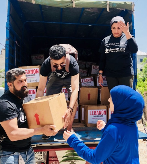 Volunteers distributing aid to Syrian refugees in Lebanon